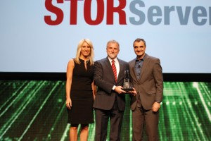 William Smoldt, President & CEO, accepts the 2014 Beacon Award from Marc Dupaquier, GM, Global Business Partners, and Kristen Lauria, VP Marketing,